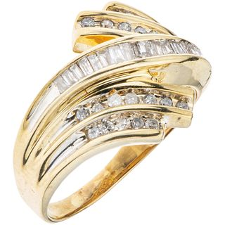 RING WITH DIAMONDS IN 10K YELLOW GOLD 8x8 and trapezoid baguette cut diamonds ~0.45 ct. Weight: 4.5 g. Size: 9