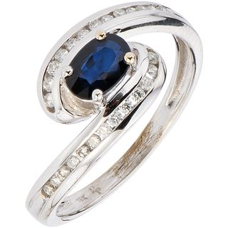RING WITH SAPPHIRE AND DIAMONDS IN 18K WHITE GOLD 1 Oval cut sapphire ~0.40 ct and brilliant cut diamonds ~0.26 ct. Size: 6 ¾