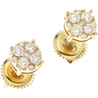 PAIR OF STUD EARRINGS WITH DIAMONDS IN 10K YELLOW GOLD Brilliant cut diamonds ~0.30 ct. Weight: 0.9 g