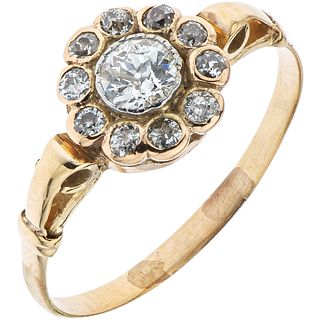 RING WITH DIAMONDS IN 14K YELLOW GOLD 1 Antique cut diamond ~0.25 ct Clarity: SI2 and antique cut diamonds ~0.25 ct