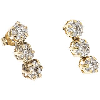 PAIR OF EARRINGS WITH DIAMONDS IN 10K YELLOW GOLD Brilliant and 8x8 cut diamonds ~0.42 ct. Weight: 2.0 g