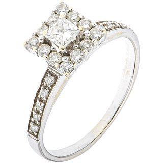 RING WITH DIAMONDS IN 14K WHITE GOLD 1 8x8 cut diamond ~0.24 ct Clarity: I2-13, Brilliant cut diamonds ~0.40 ct
