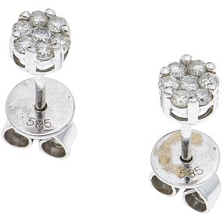 PAIR OF STUD EARRINGS WITH DIAMONDS IN 14K WHITE GOLD Brilliant cut diamonds ~0.28 ct. Weight: 1.2 g
