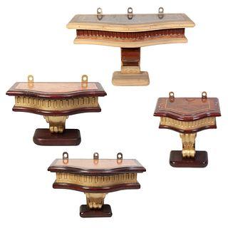 Lote de 4 peanas. SXX. Elaboradas en madera laqueada. Con cubiertas irregulares enchapadas y fustes tipo roleo.