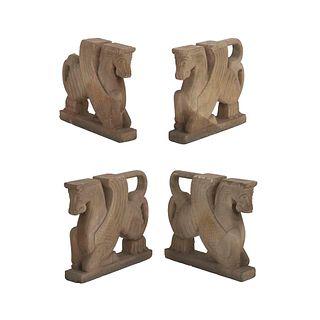 Bases para mesa. SXX. Diseño a manera de pegasos. Talla en cantera. 61 cm altura. Piezas: 4