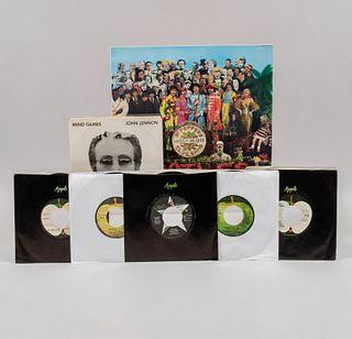 Colección de 7 discos. Siglo XX. Primeras ediciones. Consta de : A)John Lennon, Mind Games. B) Blind owl, Badfinger c)Ba...