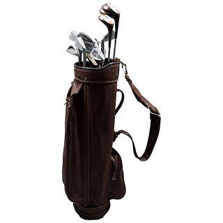 Bolso y 12 bastones de golf.  Estados Unidos, SXXI. Elaborados en metal. Marca Concorde, Wilson, MacGregor, Northwester.