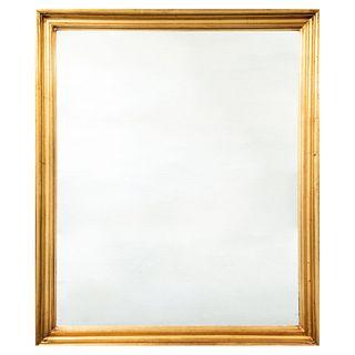 Espejo. SXX. Madera tallada y dorada.  Decorada con molduras. 78 x 68 cm Detalles de conservación.