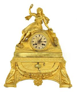 A French Egyptian Revival ormolu mantel clock,