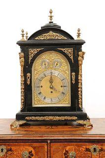 A George III-style ebonised and gilt-mounted bracket clock,