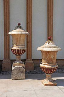 A pair of impressive alabaster Medici urns