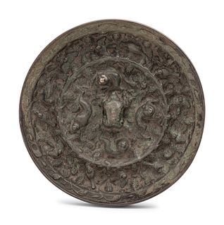 A Chinese Bronze Circular 'Mythical Beasts and Grapes' Mirror