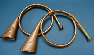 Two Copper Hunting Horns