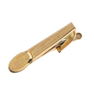 Pisa corbata en oro amarillo de 14k. Peso: 5.1 g.