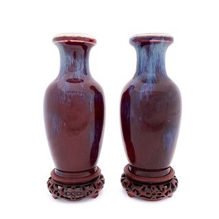 PAIR, CHINESE SANG DE BOEUF FLAMBE VASES ON STANDS