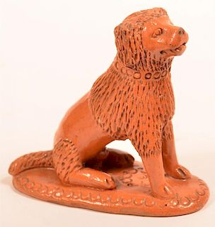 19th Century Redware Figure of a Seated Dog.