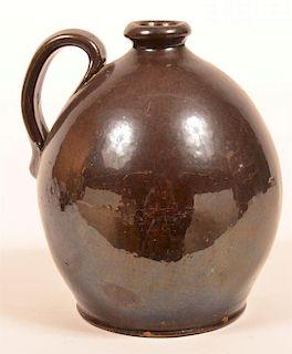 Manganese Glazed Redware Pottery Ovoid Jug.