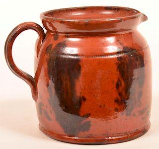 Pennsylvania Redware Pottery Pitcher.