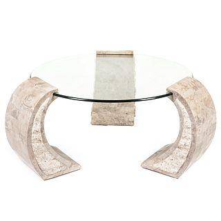 Mesa de centro. SXX. Estructura de granito beige. Con cubierta circular de vidrio biselado y soportes curvos. 49 x 130 cm