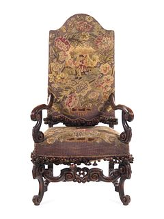 A William and Mary Style Carved Walnut Armchair with Needlepoint Upholstery