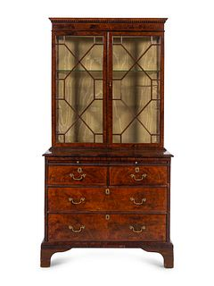 A George III Figured Walnut Bookcase-on-Chest