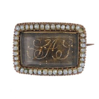 An early 19th century split pearl and hair memorial brooch. The woven hair panel with seed pearl mon