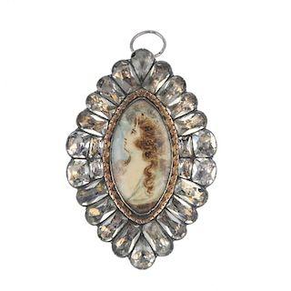 A late Georgian paste pendant. The navette-shape portrait miniature depicting a woman in profile, wi