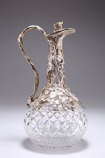 A VICTORIAN STYLE SILVER-PLATE MOUNTED CUT-GLASS CLARET JUG