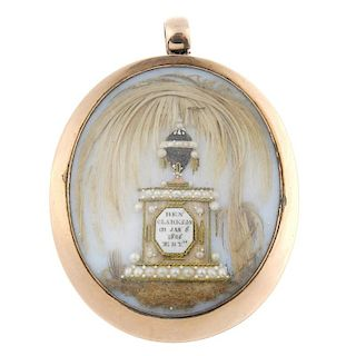 A George III gold memorial pendant. Of oval-shape outline, the opalescent glass panel with applied h