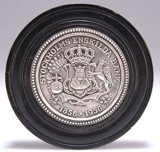 A BANK OF SWEDEN SILVER PAPERWEIGHT, by Sporrong & Co, in a