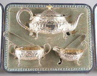 A VICTORIAN SILVER THREE-PIECE TEA SERVICE,by Horace Woodw