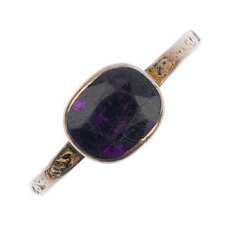 A late Georgian gold amethyst memorial ring. Designed as a collet-set foil back amethyst to the engr