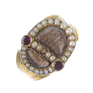 An early Victorian gem-set memorial ring. The two woven hair panels, within a split pearl surround,