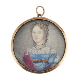 A mid 19th century gold miniature portrait pendant. The circular-shape panel, depicting an elegant l