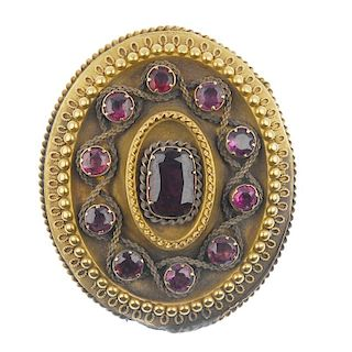 A mid 19th century garnet brooch. Of oval outline, the cushion-shape foil-back garnet, to the circul