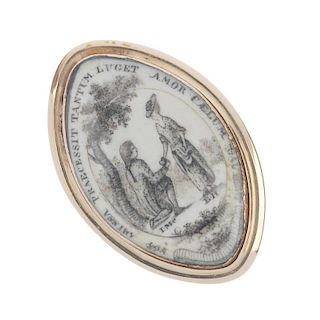 A mid 19th century memorial ring. Of marquise-shape outline, the white background with painted scene