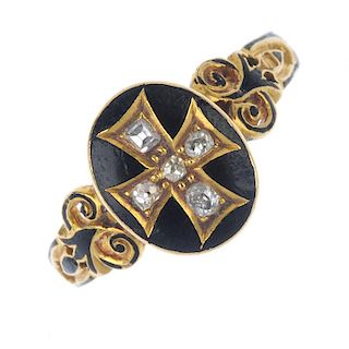 A mid Victorian 18ct gold diamond and enamel memorial ring. The old-cut diamond cross and black enam