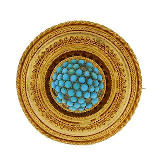A late 19th century gold turquoise memorial brooch. Of circular outline, the domed centre with caboc