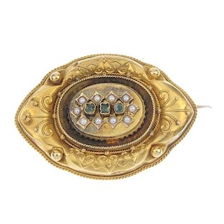 A late 19th century gold gem-set memorial brooch. Of marquise-shape outline, the foil back green-gem