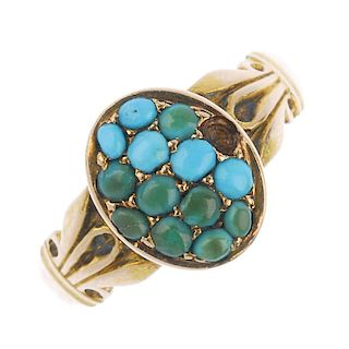 A late Victorian 15ct gold turquoise ring. The oval-shape turquoise cabochon cluster, to the scrolli