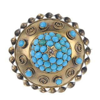 A late 19th century gold gem memorial brooch. Of circular outline, the central domed panel set with