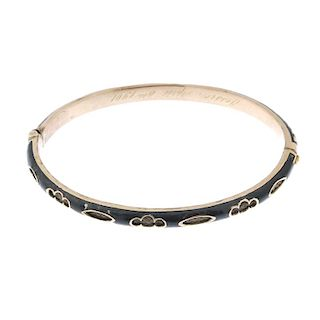 An early 20th century gold hair and enamel hinged bangle. The woven hair and openwork half bangle, h