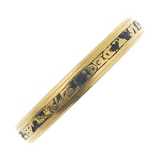 A late 19th century gold enamel memorial band ring. The central black enamel band, with raised inscr