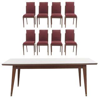 Comedor. SXX. Elaborado en madera. Consta de mesa y 8 sillas. Mesa con cubierta rectangular, fustes lisos y soportes con casquillos.