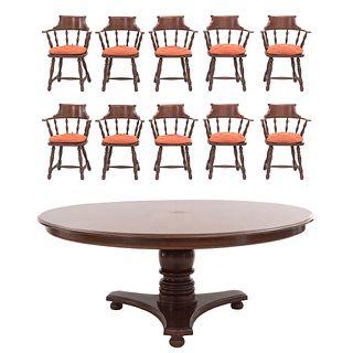 Comedor. SXX. Elaborado en madera. Consta de mesa y 10 sillones. Mesa con cubierta circular, fuste a manera de jarrón.