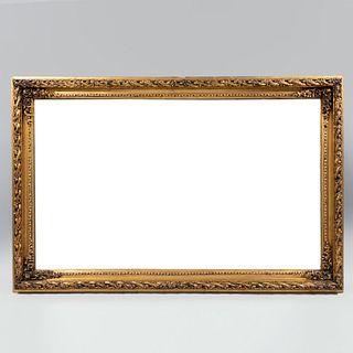 Espejo. SXX. Luna rectangular con marco de madera dorada. Decorado con elementos florales y vegetales. 74 x 114 cm.