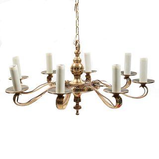 Candil. SXX. Elaborado en bronce. Brazos en C. Electrificado para 8 luces. 64 cm diametro.