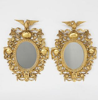 Pair of American Carved Giltwood Oval Mirrors, 19th Century