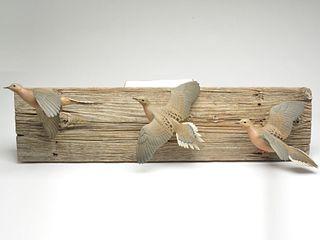 Three finely carved flying full body doves, Eddie Wozny, Cambridge, Maryland.