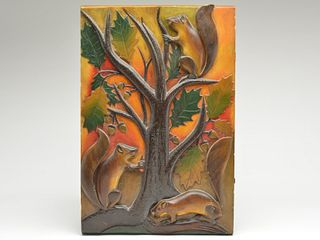 Extraordinary and early carved decorative wall plaque, Oscar Peterson, Cadillac, Michigan, 2nd quarter 20th century.